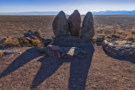 Three stones set by the nomads of Genghis Khan in the temporary parking lot - 12th century Stock Photo