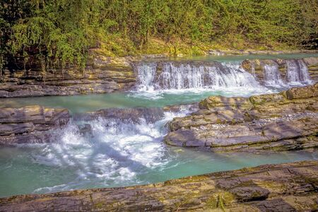 A whimsical waterfall on the river Dagomys. Sochi National Park