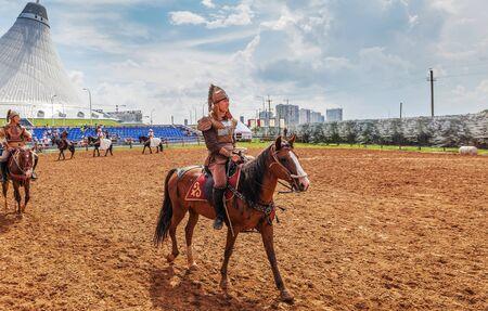 ASTANA, KAZAKHSTAN - JULY 5, 2016: Kazakh warriors on horseback during the festival of the nomadic civilization of the Millennium around Astana Editorial