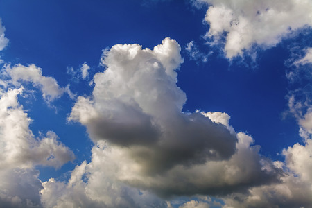 Unusual, whimsical shapes of clouds in the sky during the day.