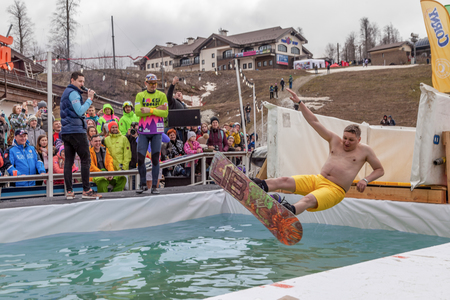 ROSA KHUTOR, SOCHI, RUSSIA-MARCH 31, 2018: Jump from springboard into pool.