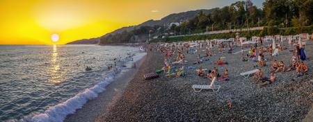 Mamaika, Sochi, Russia - July 22, 2018: Panorama of the beach at sunset. 新闻类图片