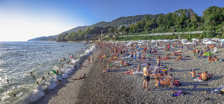 Mamaika, Sochi, Russia - July 22, 2018: People on the Black Sea beach.