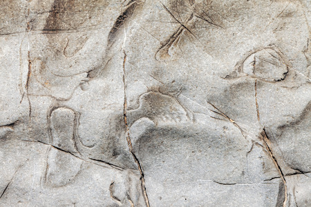 Natural, relief drawing on a mountain cliff face.