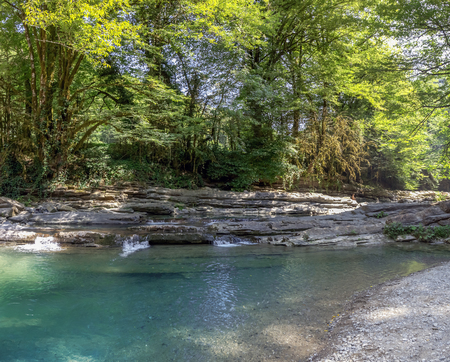 Cascade rapids and waterfalls on the river Dagomys. Sochi National Park.