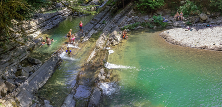 SOCHI, RUSSIA - JULY 25, 2018: People in the canyon of the river Dagomys.