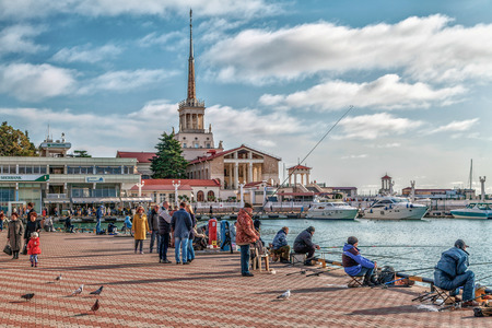 SOCHI, RUSSIA - FEBRUARY 23, 2016: Fishermen on the seaport embankment. Editorial
