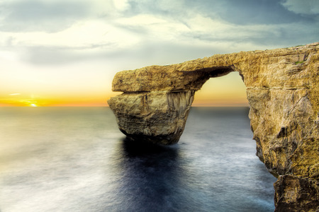 natural arch: Azure window the most popular tourist attraction. The mighty natural arch over the sea.