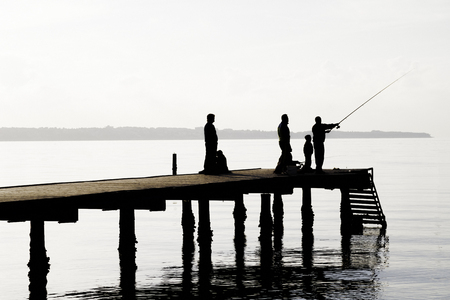Local fishermen catch fish from the pier. Locals providing fresh fish, squid, octopus and cuttlefish for luxury restaurants. Socializing with friends.