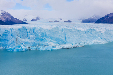 calafate: The warming of the atmosphere affects large frozen water supplies and leads to disappearing glaciers and sea level rise. Stock Photo
