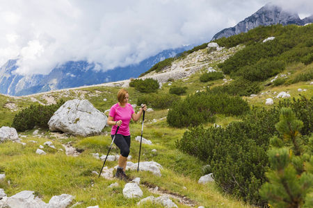 when: Active lifestyle - healthy lifestyle. Feeling good when walking in nature. Outdoor activities hiking in the mountains. Daily walk in nature.