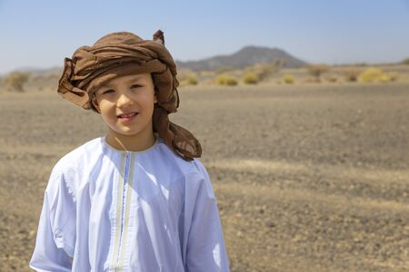 Traditional Arabic boy. Culture heritage in modern world. East vs West. Foto de archivo