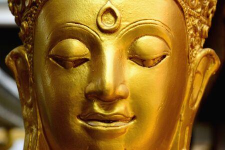 Closeup detail of golden buddha statue, selective focus