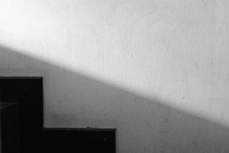 Abstracted light and shadow on the wall next to the stairs, minimalist on black and white geometric style. Banque d'images - 143480380