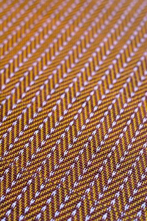 Plastic weave mat in brown color tone pattern background.