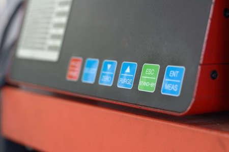 Digital diesel smoke tester at vehicle inspection station.