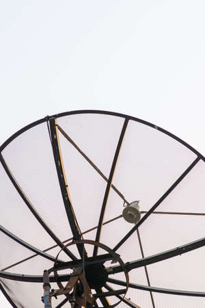 Outdoor sattelite dish isolated on sky background.