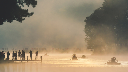 pang: Morning in Pang Ung Lake,North of Thailand, is a tourist place where people come to vacation in the winter. Because of the large reservoir The cold causes steam to rise above the surface. Editorial