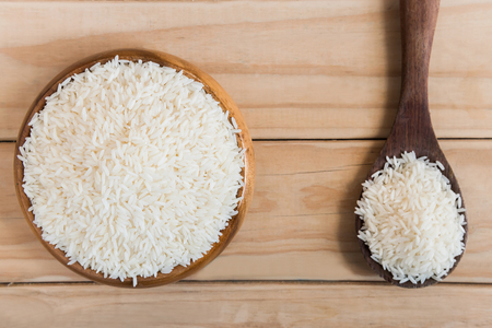 basmati rice in a wooden bowl on wooden background, basmati rice, white rice, rice photo, raw rice.