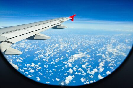 Aircraft and clouds Stock Photo