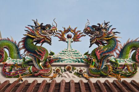 Chinese style twin dragon sculpture in the roof top Stock Photo