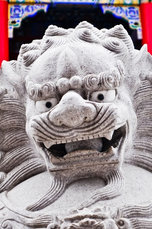stone lion: Chinese Stone Lion in Chinese Temple ,Thailand Stock Photo