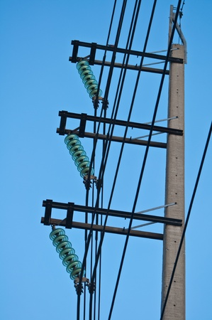 Electric poles and power lines in black photo