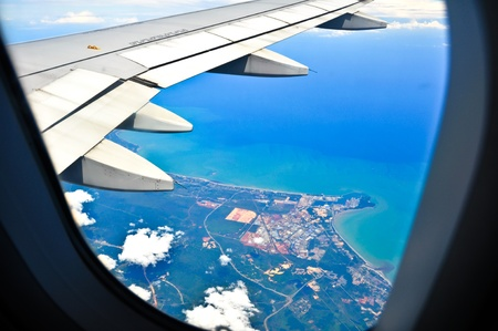 View from a jet plane window high on the blue skies Stock Photo - 11255091