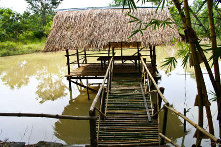 Entrance to bamboo houses on the lake Stock Photo