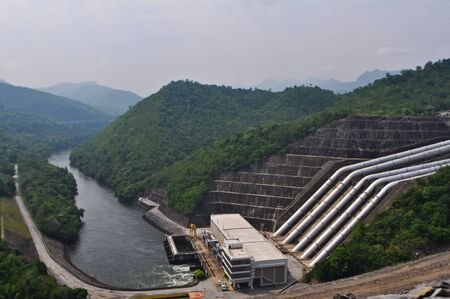 Large electric power dam in valley of western Thailand  Stock Photo - 11537959