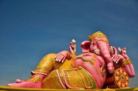 siddhivinayaka: Big pink ganecha in relaxing  on blue sky  ,Wat Samarn in Chachoengsao Thailand.