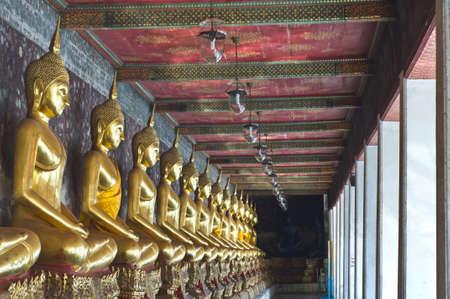transcendental: A row of buddha Wat Sutuch in Bangkok Thailand