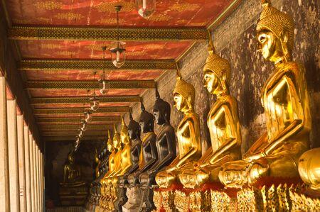 transcendental: A row of golden  buddha and black buddha ,Bangkok Thailand Stock Photo