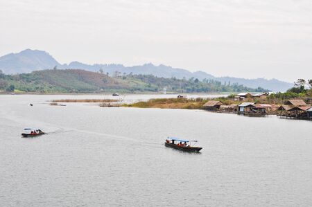 Tourist boat travel in the lake ,Thailand photo