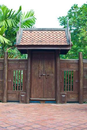 Ancient door of house,Thailand photo