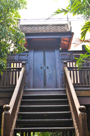 Stair to the door of ancient house photo