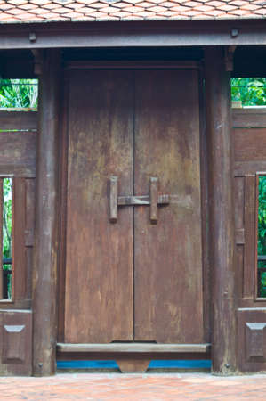 Ancient  wooden door in house,Thai style photo