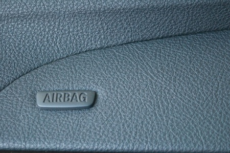 Airbag symbol on leather console in a car photo