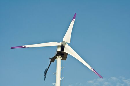 Wind turbine in the blue sky photo