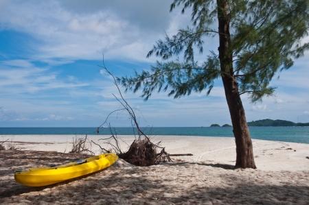Yellow kayak on the beach, Lipe island in Thailand photo