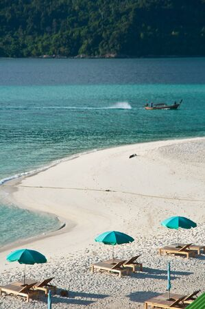 thassos: Empty sunbeds with parasol in Lipe Beach,Thailand