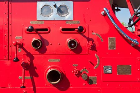 Old firefighters equipment  on the fire truck photo