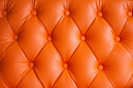 Orange Leather Upholstery Background  photo