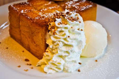 Vanilla ice cream with white cream and  bread Stock Photo - 13996854