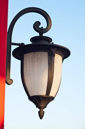 metall lamp: Antique lamp on the red  pole