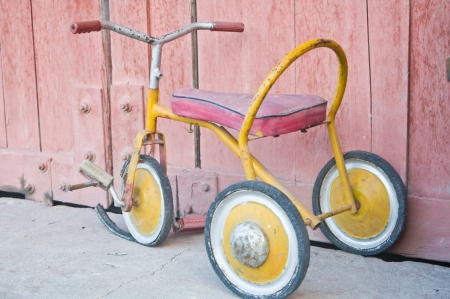 antique tricycle: Vintage children tricycle Stock Photo