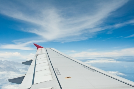 View of airplane wing  above white cloud  Stock Photo