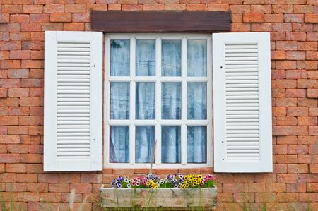 pane:  White window on red brick wall  Stock Photo