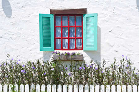 Colorful window on white wall of vintage house style photo