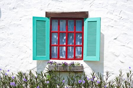 window on white wall of vintage house style photo